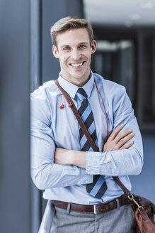 Portrait of smiling businessman - UUF11892