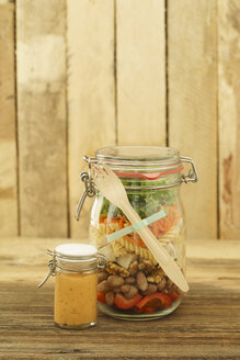 Preserving jar of vegan mixed salad with tofu and pasta and jar of cocktail sauce - ECF01892