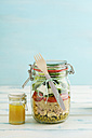 Preserving jar of mixed salad with peas, tuna, couscous, tomatoes, tuna, feta and jar of vinaigrette dressing - ECF01895