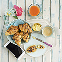 Breakfast with chocolate croissants and smartphone - ECF01911