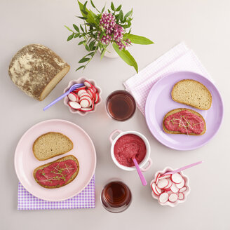Vegan supper with bread, beetroot spread, red radish and juice - ECF01932