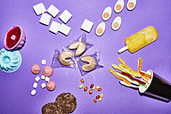 Different sorts of sweets on purple background - PNEF00002