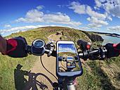 France, Bretagne, Sainte-Anne la Palud, Plage de Treguer, cell phone on mountain e-bike - LAF01909