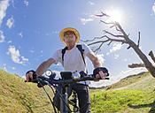 France, Bretagne, Sainte-Anne la Palud, Plage de Treguer, senior man riding mountain e-bike - LAF01912