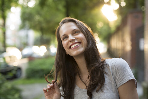 Portrait of happy young woman outdoors - PNEF00056