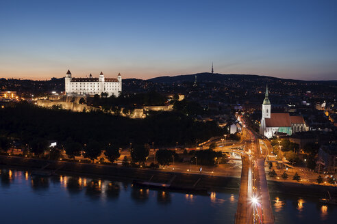Slovakia, Bratislava, city at dusk with lighted Bratislava Castle and St. Martin's Cathedral - ABOF00273