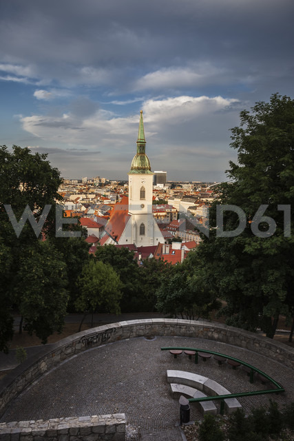 Slovakia, Bratislava, cityscape with St. Martin's Cathedral at sunset, hill park terrace with benches - ABOF00279