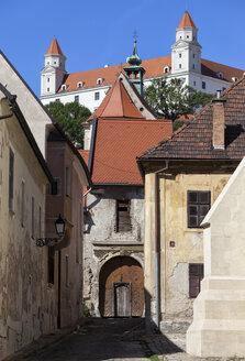 Slovakia, Bratislava, Old Town houses with Bratislava Castle above - ABOF00285