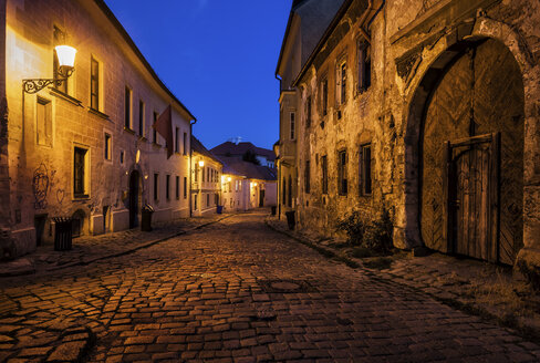 Slovakia, Bratislava, Old Town at night, cobbled street, old building with aged facade - ABOF00288