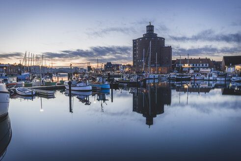 Germany, Eckernfoerde, view to old silo and harbour at morning twilight - KEBF00634