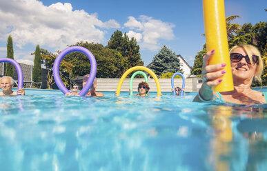 Group of seniors doing water gymnastics in pool - PNPF00103