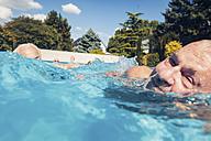 Seniors swimimng in swimming pool - PNPF00109