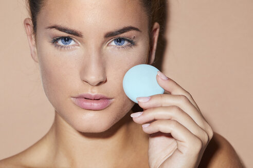 Portrait of beautiful young woman holding beauty product - PNEF00072