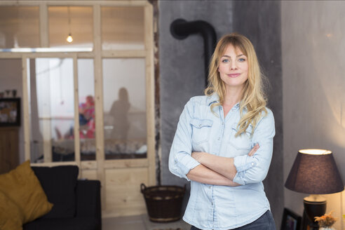 Portrait of confident blond woman at home - PNEF00105