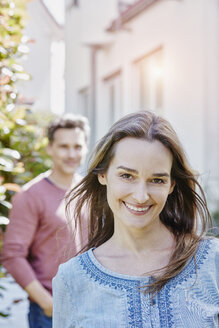 Portrait of smiling woman with man in background - RORF01052