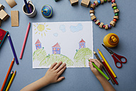Child drawing landscape with houses - RBF06080