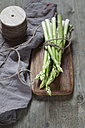 Bunch of green asparagus on wooden board - SBDF03310
