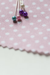 Fixing pins on cloth - NGF00428