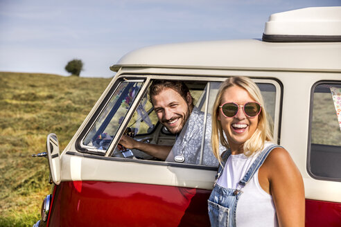 Happy couple with van in rural landscape - FMKF04557