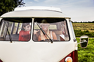 Two happy women in a van - FMKF04587