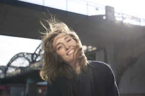 Portrait of happy woman with blowing hair - PNEF00165