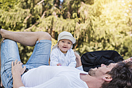 Happy father with baby girl in park - DIGF02874