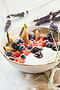Bowl of Greek yoghurt with fig, watermelon, frozen berries and lavender honey - SBDF03322