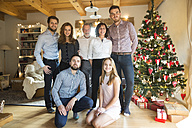 Portrait of family at Christmas tree - HAPF02171