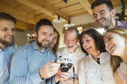 Laughing family looking at camera - HAPF02174