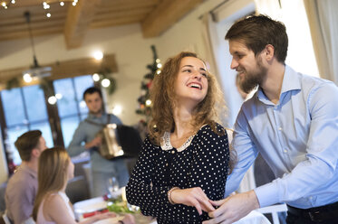 Young couple dancing on a Christmas party - HAPF02210