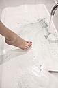 Woman taking bath, partial view - CHPF00438