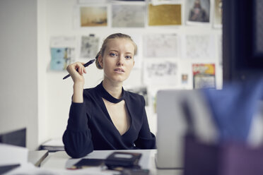 Portrait of young businesswoman at desk in the office - PNEF00176