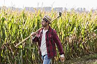 Farmer walking along cornfield - UUF11913