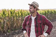 Farmer standing on field looking sideways - UUF11916