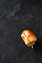 Organic orange bell pepper on dark ground - CSF28348