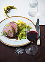 Beef fillet with savoy cabbage and mashed potatoes and glass of red wine - PPXF00094