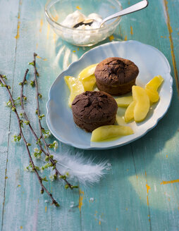 Chocolate muffin with mango slices on plate - PPXF00106