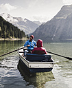 Austria, Tyrol, Alps, couple in rowing boat on mountain lake - UUF11954
