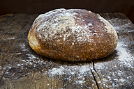 Wheat bread powdered with flour on dark wood - LVF06350