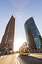 Germany, Berlin, Potsdamer Platz, skyscrapers and double-decker bus at backlight - WD04184