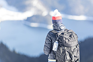 Germany, Bavaria, Alps, hiker with backpack at Lake Walchen - MMAF00149