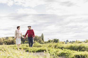 Senior couple on a walk in rural landscape - UUF12039