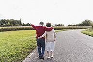 Senior couple on a walk in rural landscape - UUF12054