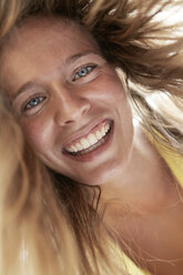 Portrait of happy young woman - PNEF00220