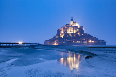 France, view to lighted Mont Saint-Michel at low tide and blue hour - FCF01288