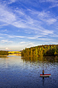 Germany, man in a boat fishing on a dam - PUF00807