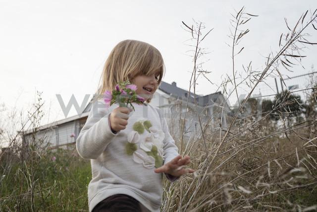 Carefree little girl picking flowers - KMKF00031