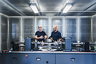 Two colleagues working in modern factory - DIGF02952