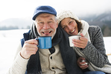 Portrait of senior couple with hot beverages in winter - HAPF02264