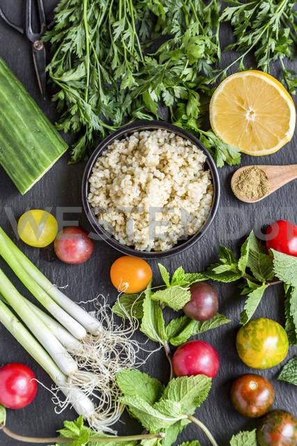 Bowl of Bulgur and ingredients for preparing Tabbouleh - SARF03387